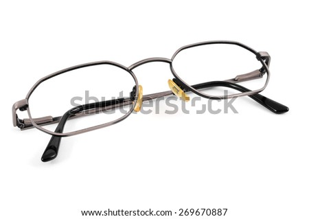 closeup of a pair of metal-rimmed eyeglasses on a white background - stock photo