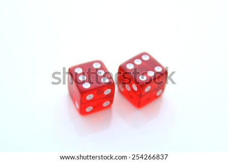 Closeup of a pair of red dices over white background - stock photo