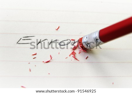 closeup of a pencil eraser correcting an error - stock photo