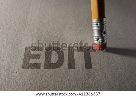 Closeup of a pencil erasing Edit text -- proofreading or editing concept                                - stock photo