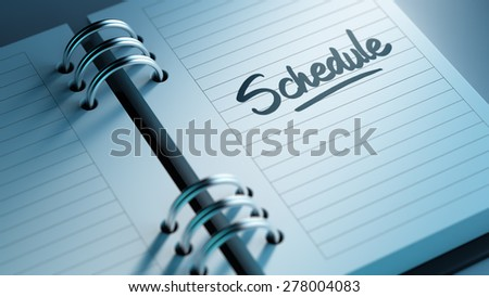 Closeup of a personal agenda setting an important date representing a time schedule. The words Schedule written on a white notebook to remind you an important appointment. - stock photo