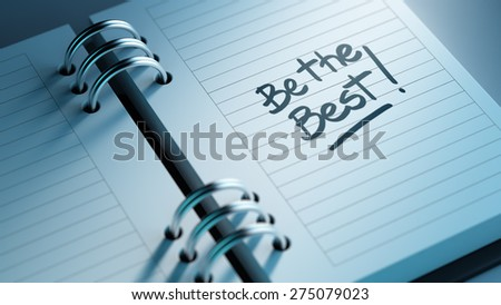 Closeup of a personal agenda setting an important date representing a time schedule. The words Be the best written on a white notebook to remind you an important appointment. - stock photo