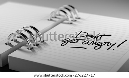 Closeup of a personal agenda setting an important date representing a time schedule. The words Don't get angry written on a white notebook to remind you an important appointment. - stock photo