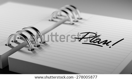 Closeup of a personal agenda setting an important date representing a time schedule. The words Plan written on a white notebook to remind you an important appointment. - stock photo