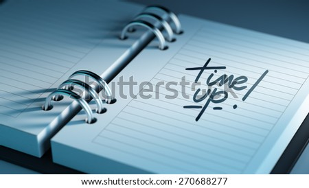 Closeup of a personal agenda setting an important date representing a time schedule. The words Time up written on a white notebook to remind you an important appointment. - stock photo
