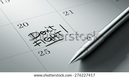 Closeup of a personal agenda setting an important date written with pen. The words Don't Fight written on a white notebook to remind you an important appointment. - stock photo
