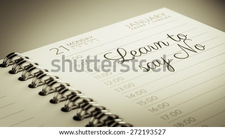 Closeup of a personal calendar setting an important date representing a time schedule. The words Learn to say no written on a white notebook to remind you an important appointment. - stock photo