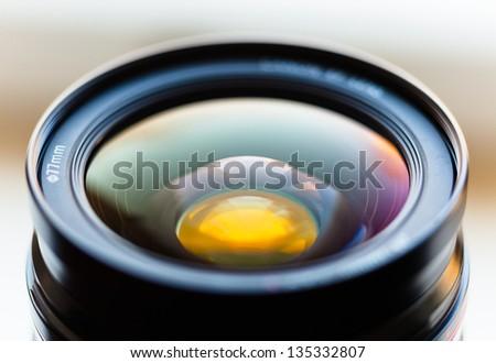 Closeup of a photographic lens - stock photo