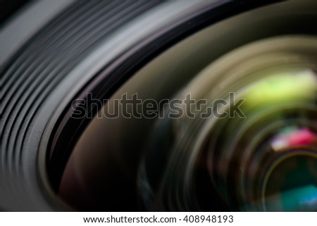 Closeup of a photographic lens with lense reflections - stock photo