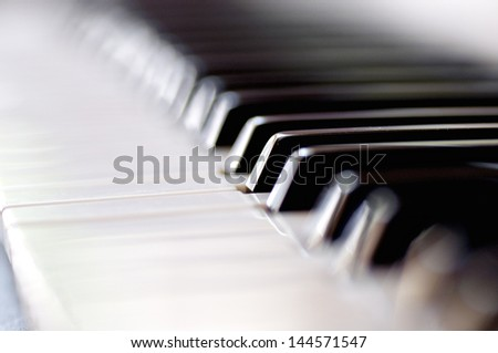 Closeup of a pianos black and white keys. Selective focus with shallow depth of field. - stock photo