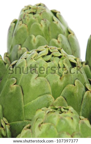closeup of a pile of artichokes - stock photo