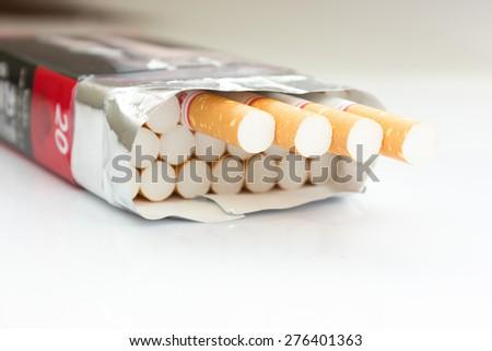 Closeup of a pile of cigarettes - stock photo