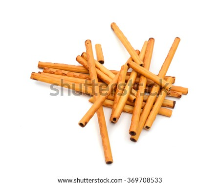 Closeup of a pile of delicious pretzel sticks isolated on white background - stock photo