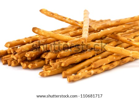 Closeup of a pile of delicious pretzel sticks isolated on white background (selective DOF) - stock photo