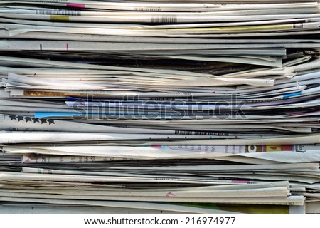 Closeup of a pile of newspapers / A pile of newspapers - stock photo