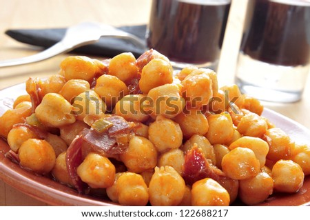 closeup of a plate with spanish garbanzos con jamon, chickpeas with serrano ham, served as tapas - stock photo