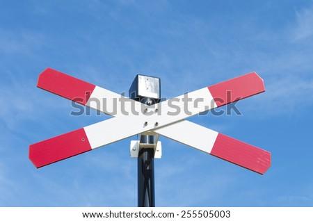 closeup of a railroad crossing sign - stock photo