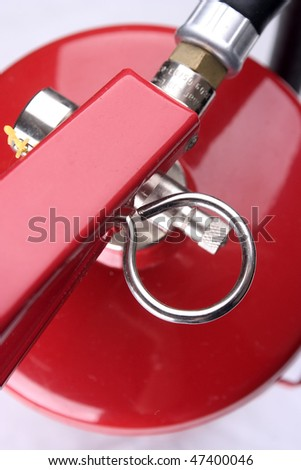 Closeup of a red fire extinguisher. - stock photo