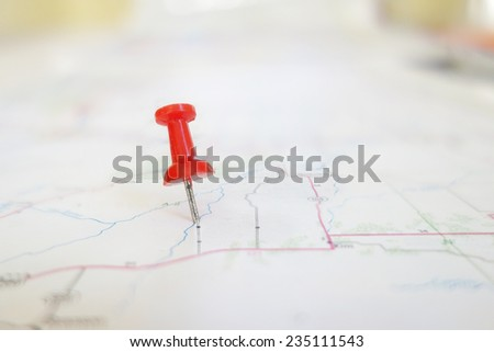 closeup of a red tack in a map                                - stock photo