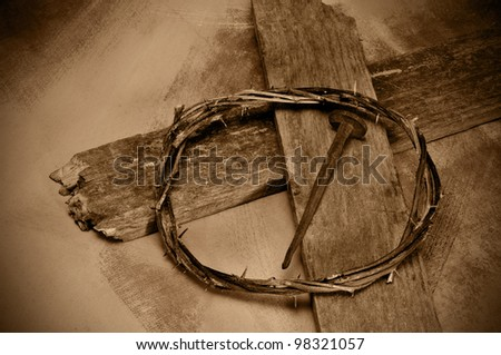 closeup of a representation of the Jesus Christ crown of thorns, cross and nail - stock photo