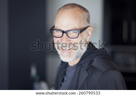 Closeup Of A Senior Man Smiling At The Camera - stock photo