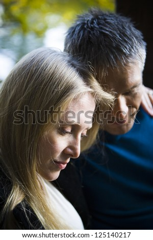 Closeup of a serious middle aged caucasian couple - stock photo