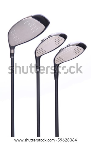 Closeup of a set of three golf metal drivers on a white background. - stock photo