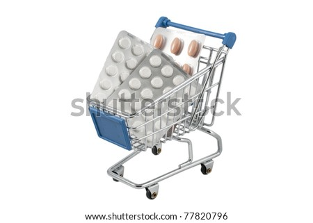 Closeup of a shopping cart full of pills (isolated on white) - stock photo