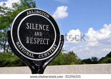 "Closeup of a ""Silence and respect"" sign at the Arlington National Cemetery in Arlington, Virginia, near Washington DC - stock photo"