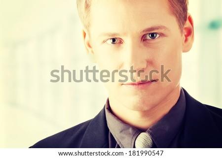 Closeup of a smart handsome business man  - stock photo