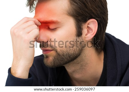 Closeup of a stressed handsome young man over white background - stock photo