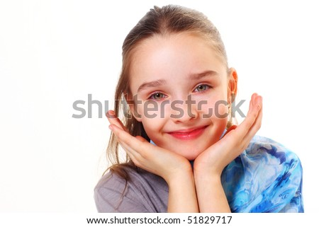 closeup of a sweet little girl smiling on white background - stock photo