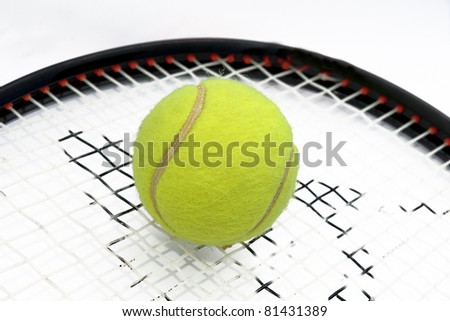 closeup of a tennis racket and tennis-ball - stock photo