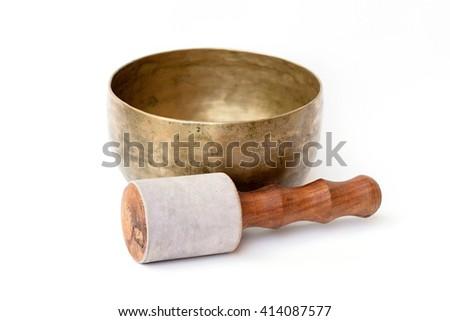 closeup of a tibetan bowl on a white background - stock photo