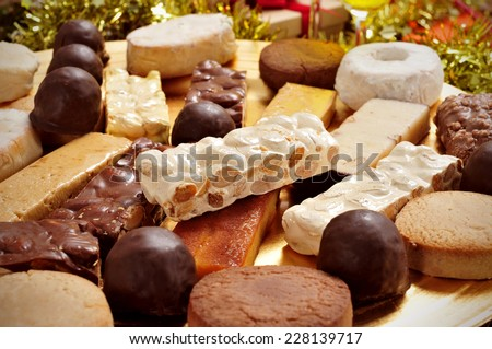 closeup of a tray with different turron, mantecados and polvorones, typical christmas sweets in Spain - stock photo