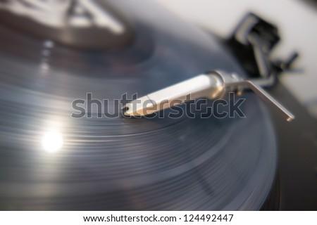 Closeup of a vinyl record and needle - stock photo