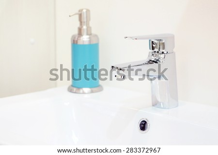 Closeup of a wash basin in a modern bathroom - stock photo