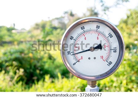 Closeup of a water pressure meter,Water gauge - stock photo
