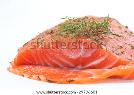 Closeup of a whole piece of smoked salmon with dill on white - stock photo