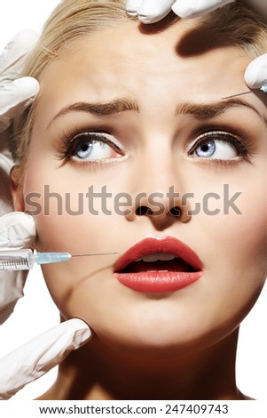 Closeup of a woman getting botox or filler done. - stock photo