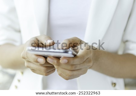 Closeup of a woman hands using tablet  - stock photo