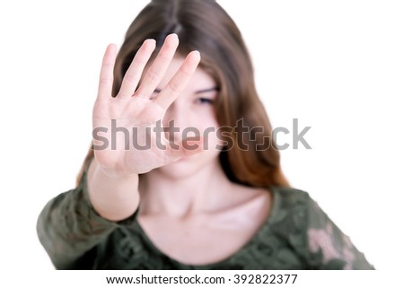 Closeup of a woman protecting herself from an aggressor, isolated in white - stock photo