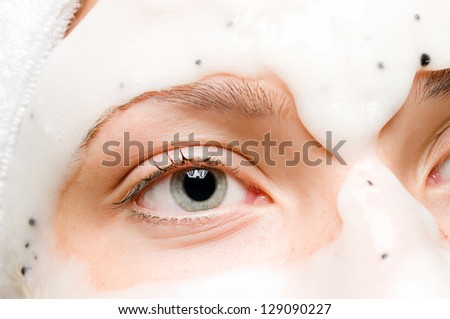 Closeup of a woman with beauty mask on her face - stock photo