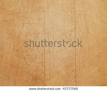 closeup of a worn wooden cutting board - stock photo