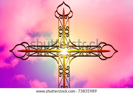 closeup of a wrought iron cross over the sky with the sunshine - stock photo