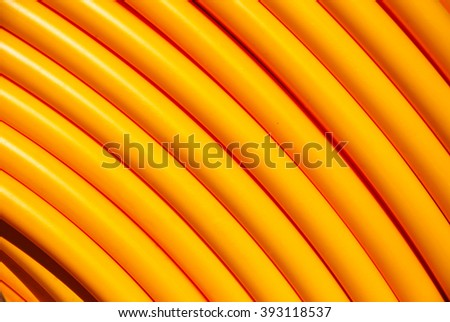 Closeup of a yellow internet cable roll - stock photo