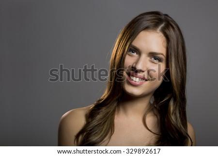 Closeup of a young beautiful woman. - stock photo