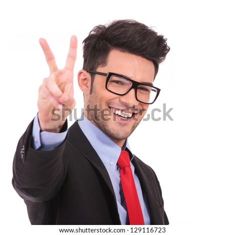 closeup of a young business man showing victory sign on white background - stock photo