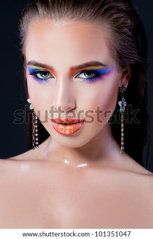 Closeup of a young lady with creative makeup - stock photo