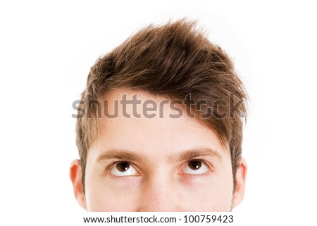 closeup of a young man looking up - stock photo
